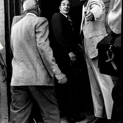 Criminal Court Judge Philip Romiti looks back before entering apartment at 2337 W. Monroe where Fred Hampton and Mark Clark were shot to death in Dec. 4, 1969.