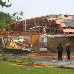 The Green Oaks Nursing and Rehabilitation center is damaged after tornadoes swept through the area, Tuesday, April 3, 2012, in Arlington, Texas.
