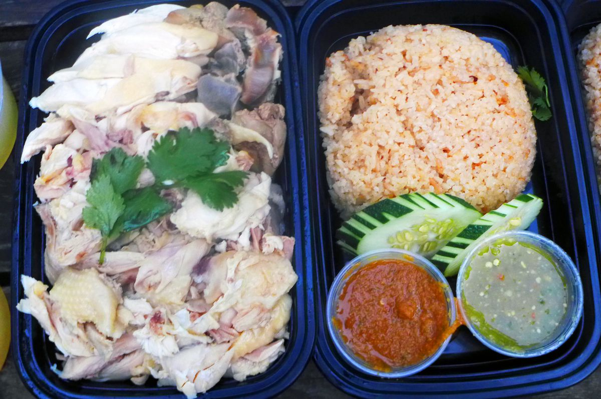 Khao man gai, with giblets, rice, and dipping sauces