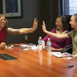"""Olympic silver medalist Noelle Pikus-Pace high-fives Tara Jeppsen, 13, during a small group discussion about her new book, """"Focused: Keeping Your Life on Track, One Choice at a Time,"""" at Deseret Book corporate headquarters, Tuesday, Sept. 9, 2014."""