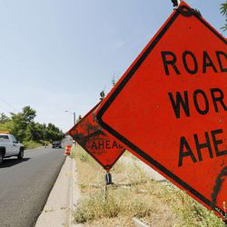 Motorists drive through road construction in Farmington Tuesday, June 30, 2015. Eighty Utah cities and towns passed or considered resolutions this month to support increased transportation funding to meet critical community needs. The funding option was made possible by HB 362.