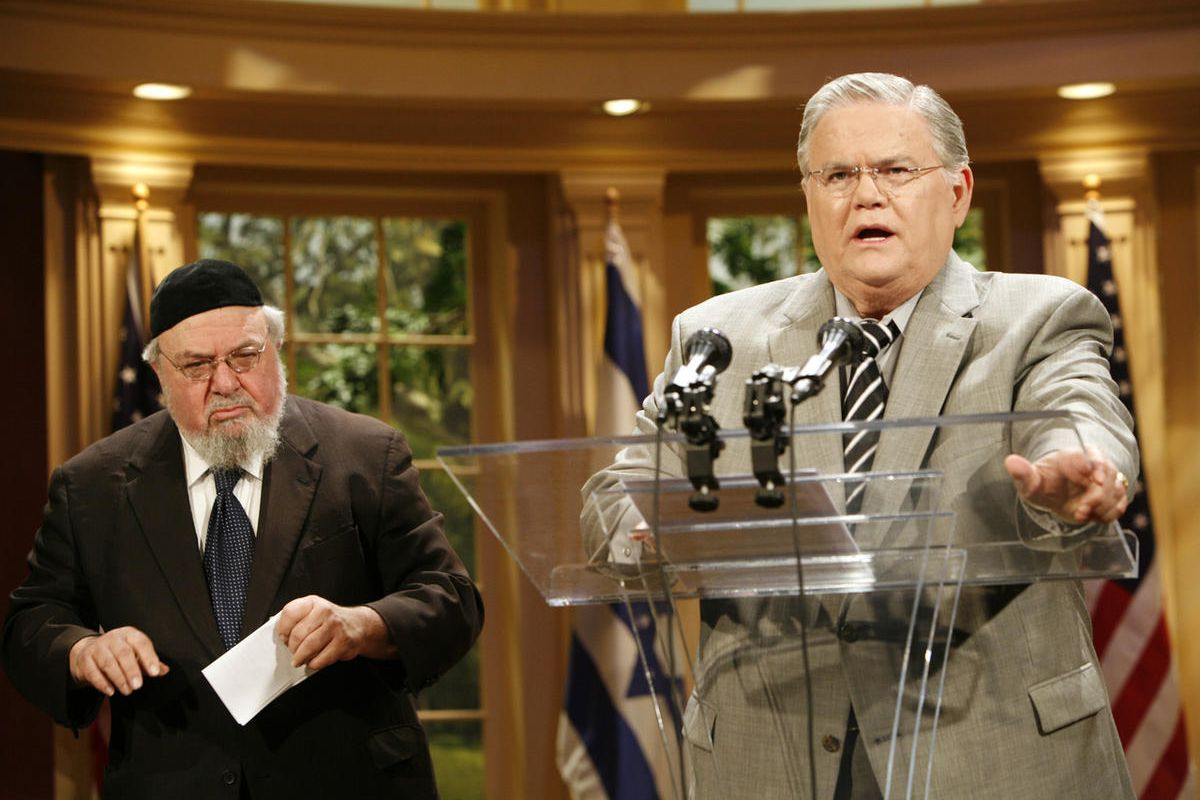 Rabbi Aryeh Scheinburg, left, of Congregation Rodefei Shalom Synagogue in San Antonio, listens as the Rev. John Hagee speaks during a news conference held at the Cornerstone Church in San Antonio on Friday, May 23, 2008. The Texas pastor and televangelist