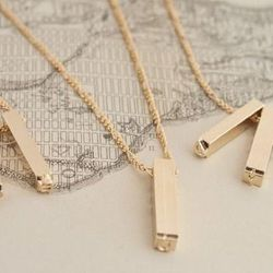 """If you don't know anything more than her name, gift her an <b>Erica Weiner</b> Letterpress Necklace in gold plate customized with her initials, <a href=""""http://ericaweiner.com/collections/collection-necklaces-view-all/products/double-letterpress-necklace-"""
