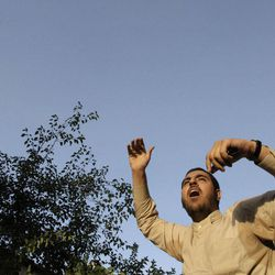 An Iranian protestor chants slogan in front of the French Embassy during a demonstration to condemn a French magazine caricaturing prophet Muhammad in Tehran, Iran, Sunday, Sept. 23, 2012.
