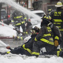 Chicago Fire Department firefighters battle a blaze in subzero temperatures. | Ashlee Rezin/Sun-Times