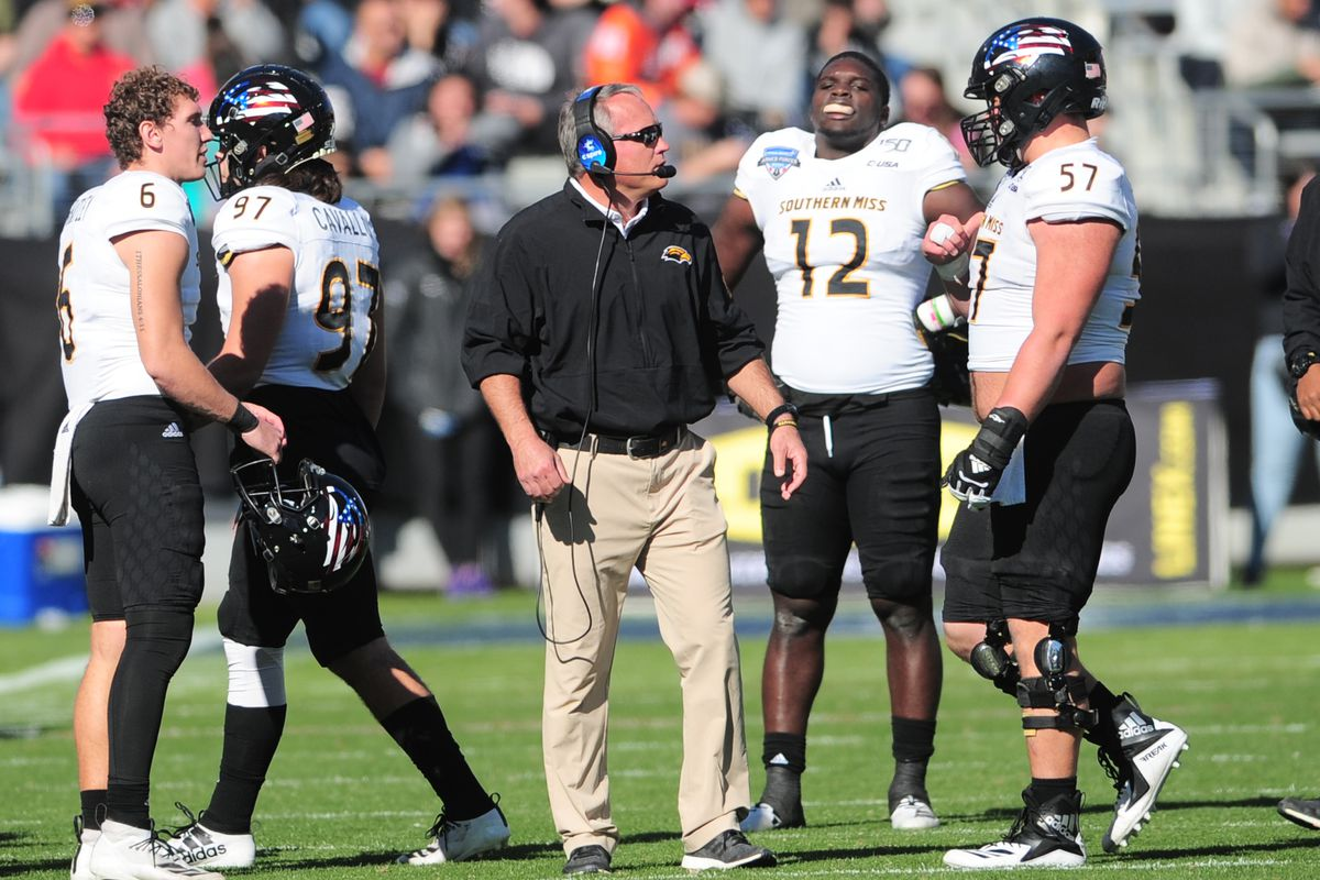 Southern Mississippi Golden Eagles head coach Jay Hopson chats with Trace Clopton during the Armed Forces Bowl against the Tulane Green wave on January 4, 2020 at Amon G. Carter Stadium in Fort Worth, TX.