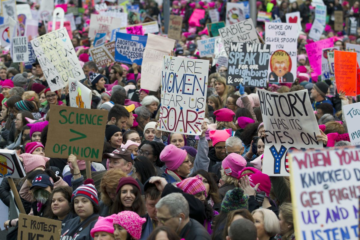 Women with bright pink hats and signs begin to gather early and are set to make their voices heard on the first full day of Donald Trump's presidency, Saturday, Jan. 21, 2017 in Washington. Organizers of the Women's March on Washington expect more than 20