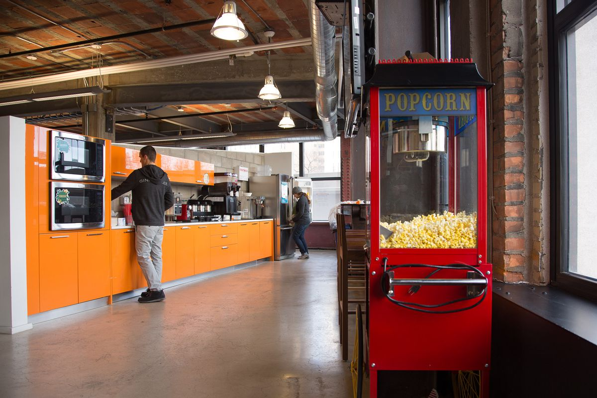 This Madison Building office kitchen offers free slushies and popcorn and looks out over Tiger Stadium.