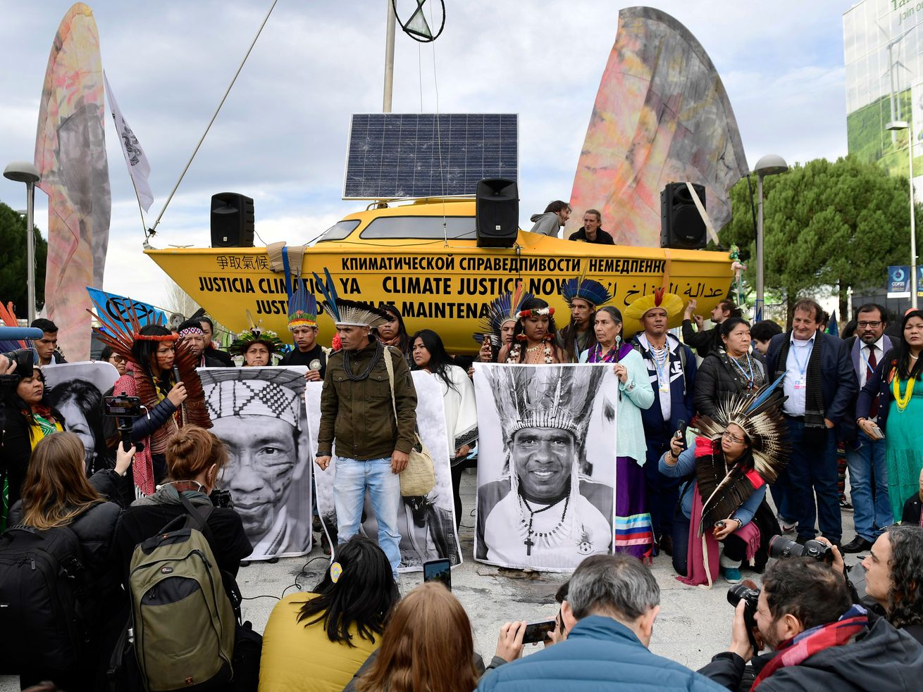 Brazilian natives take part in a demonstration demanding climate justice outside the venue of the UN Climate Change Conference COP25 at the 'IFEMA - Feria de Madrid' exhibition centre, in Madrid, on December 9, 2019.
