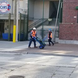 Slowly, very slowly, seats are walked out of Wrigley