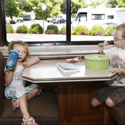 Anya, 3, and Ethan Scott, 4, of Salt Lake City enjoy snacks Monday while visiting grandparents Gary and Jeanie Schekel of Newport, Ore., who are in Provo at BYU Education Week.