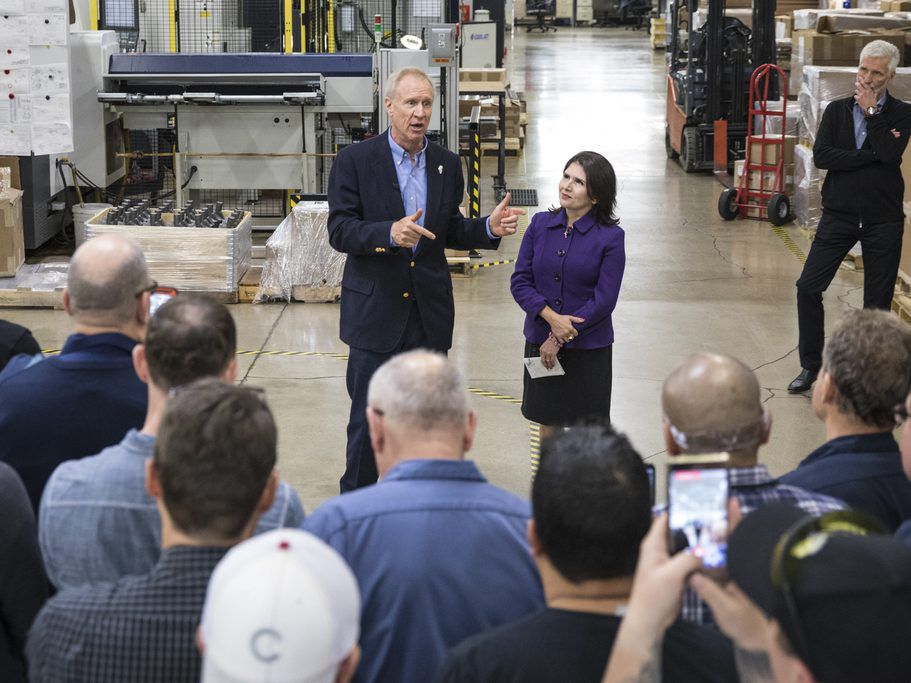 Gov. Bruce Rauner and Lt. Gov. Evelyn Sanguinetti speak to employees at ERA Industries in Elk Grove Village after Rauner sat down for an interview on his campaign bus with Chicago Sun-Times political reporter Tina Sfondeles, Tuesday afternoon, Oct. 20, 20
