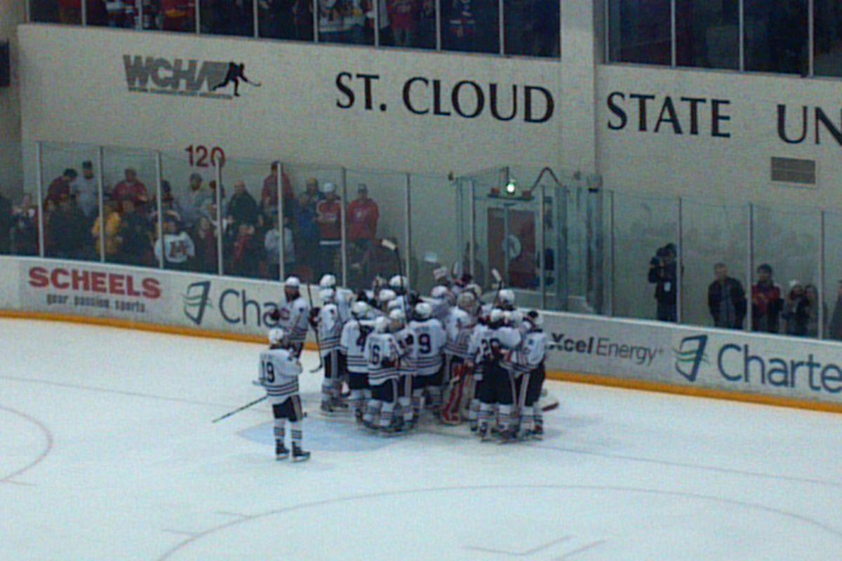 The Huskies celebrate after knocking off No. 1 Minnesota Saturday