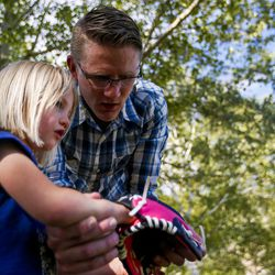 Alex Jensen instructs his daughter Olivia Jensen, 5, how to catch, at Edgemont South Stake Park in Provo on Tuesday, May 30, 2017.
