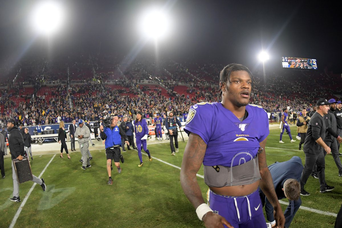 Baltimore Ravens quarterback Lamar Jackson walks off the field after the game against the Los Angeles Rams at Los Angeles Memorial Coliseum.