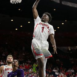 Arizona's Devonaire Doutrive (1) goes for a dunk during the Arizona-Western New Mexico University game in McKale Center on October 30 2018 in Tucson, Ariz.
