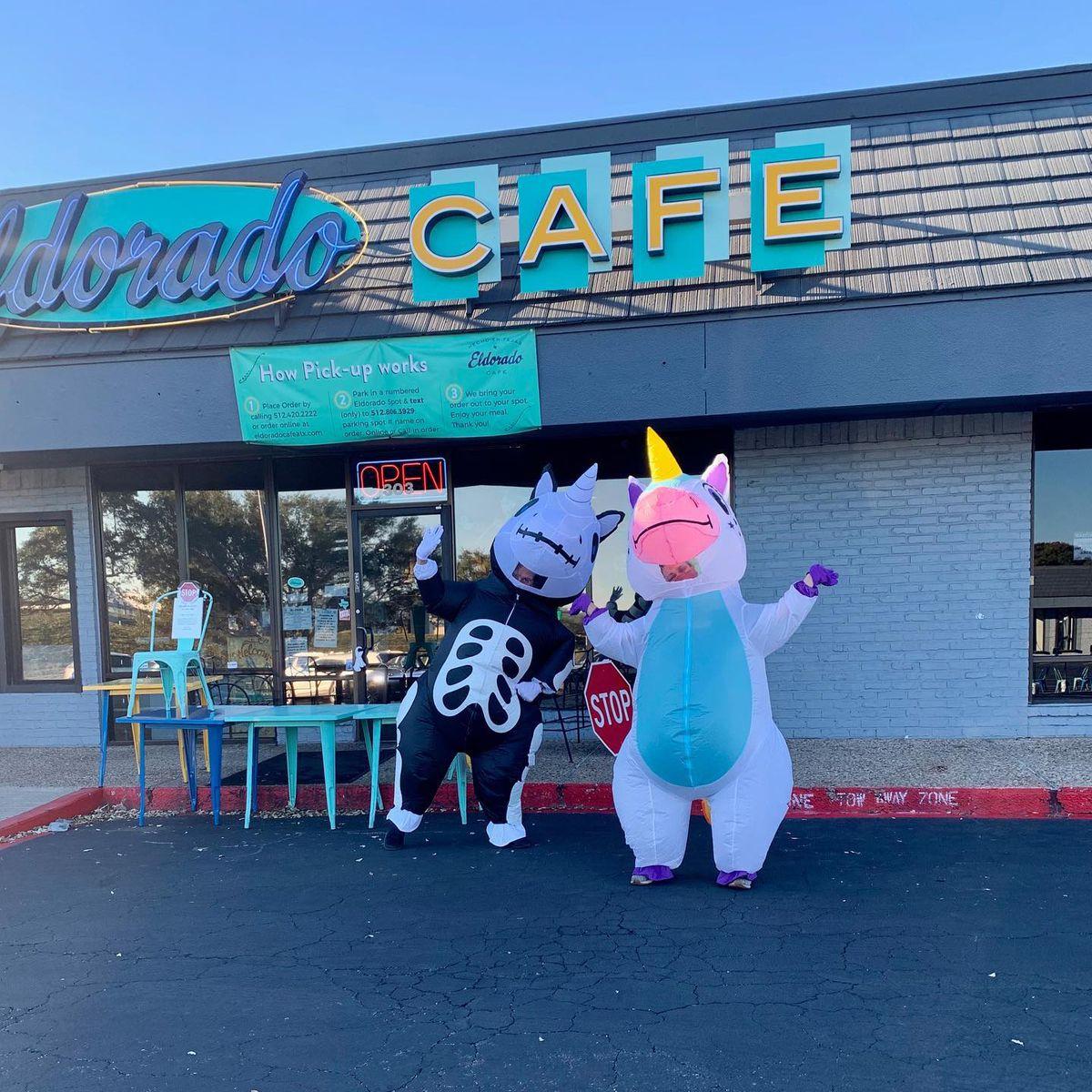 The Eldorado Cafe staff in inflatable unicorn costumes