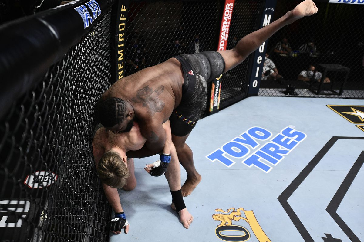 Curtis Blaydes takes down Alexander Volkov of Russia in their heavyweight bout during UFC Fight Night at UFC APEX