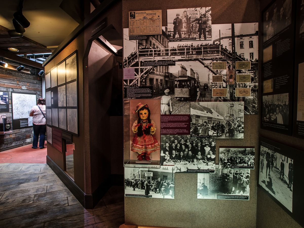 A wall of photographs in the Holocaust exhibit at The Breman Museum.
