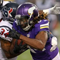 Aug 9, 2013; Minneapolis, MN, USA; Minnesota Vikings wide receiver Cordarrelle Patterson (84) attempts to break a tackle from Houston Texans cornerback A.J. Bouye (34) after catching a pass in the second quarter at the Metrodome.