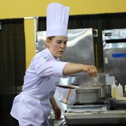 Utah Valley University culinary student Madeline Black concentrates as she cooks during the American Culinary Federation Cook. Craft. Create. national convention on July 8-13 in Orlando, Florida. Black was named the National Student Chef of the Year after making truffle-scented duck roulade finished in duck fat, with Utah honey lacquered duck thigh-riblet.