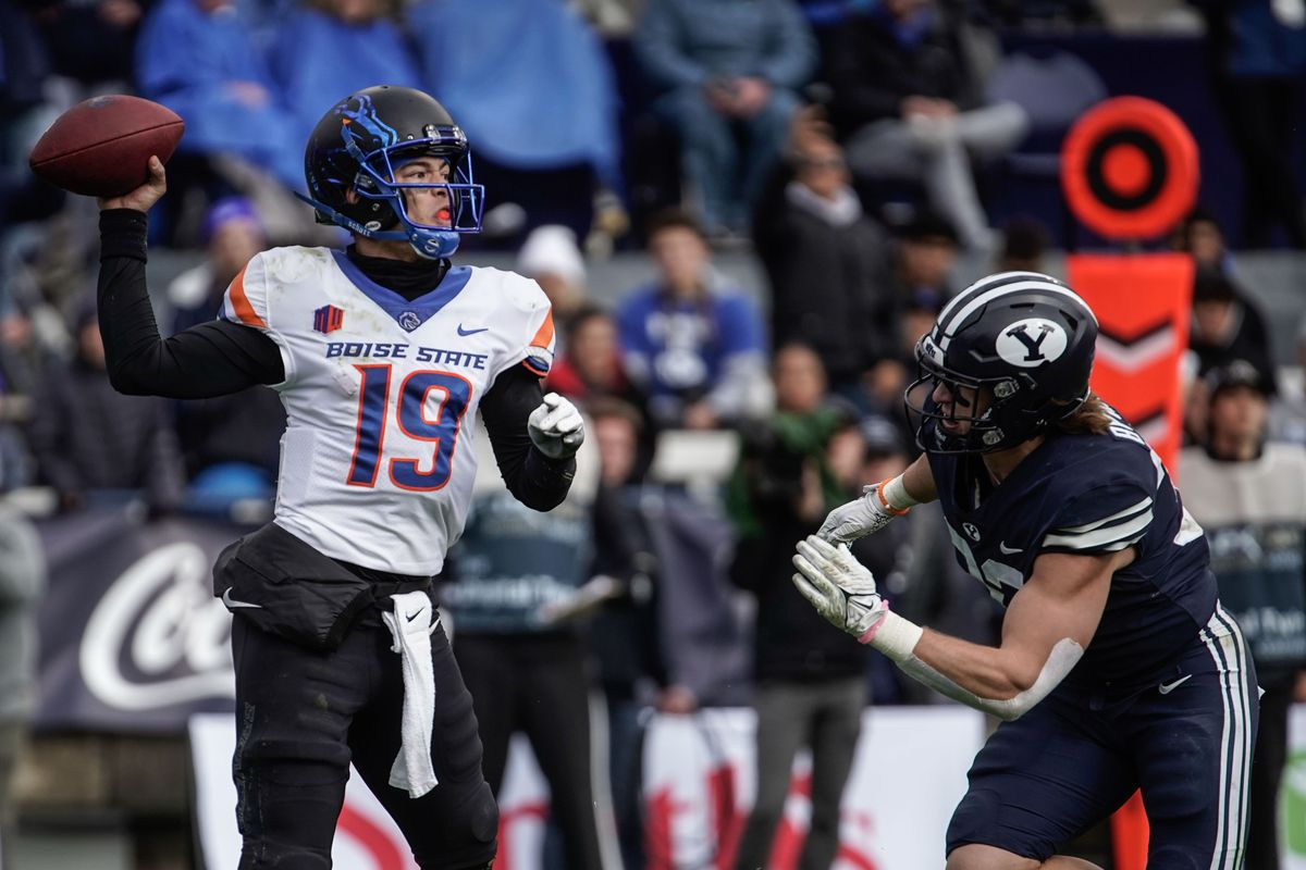 Boise State quarterback Hank Bachmeier (19) looks to throw the ball as BYU linebacker Ben Bywater approaches to tackle during an NCAA college football game at LaVell Edwards Stadium in Provo on Saturday, Oct. 9, 2021.