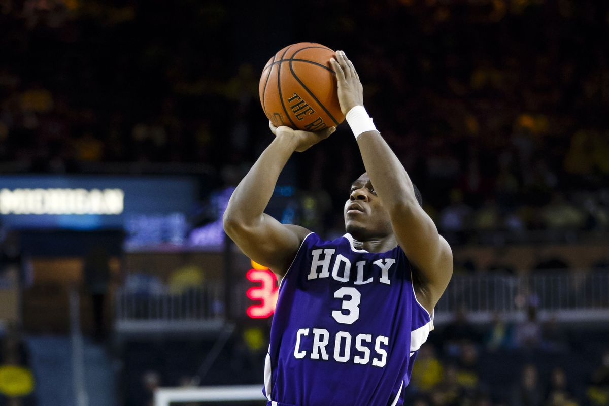 Justin Burrell's late three iced Holy Cross' lead.
