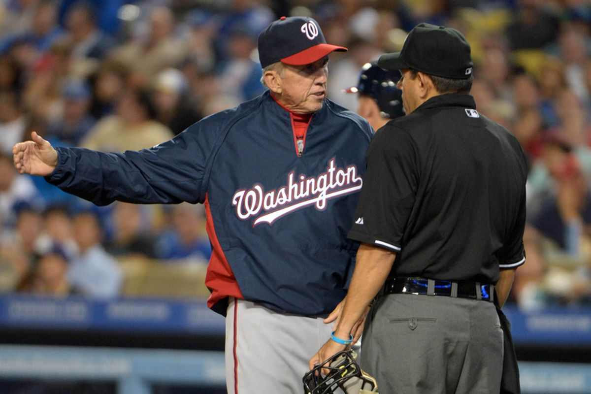 May 15, 2013; Los Angeles, CA, USA; Washington Nationals manager Davey Johnson (left) argues with home plate umpire Alfonso Marquez (72) in the sixth inning against the Los Angeles Dodgers at Dodger Stadium. The Dodgers defeated the Nationals 3-1.