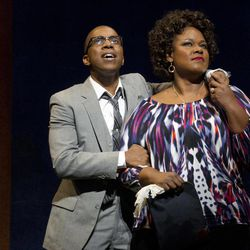 """In this theater image released by Boneau/Bryan-Brown, Leslie Odom, Jr., left, and Kecia Lewis-Evans are shown during a performance of """"Leap of Faith,"""" at the St. James Theatre in New York."""