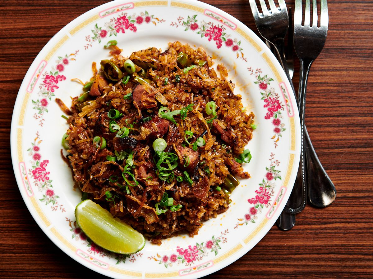 A plate of barbecue pork fried rice sits on an ornate floral plate at Eem