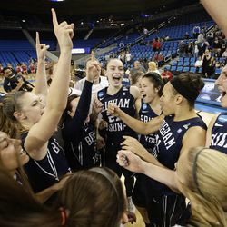 BYU players celebrate their team's 80-76 win against Nebraska in a second-round game of the NCAA women's college basketball tournament on Monday, March 24, 2014, in Los Angeles. (AP Photo/Jae C. Hong)