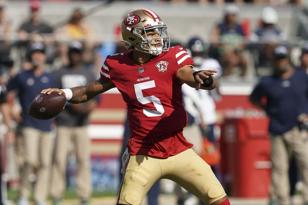 San Francisco 49ers quarterback Trey Lance (5) throws a touchdown during the third quarter against the Seattle Seahawks at Levi's Stadium.