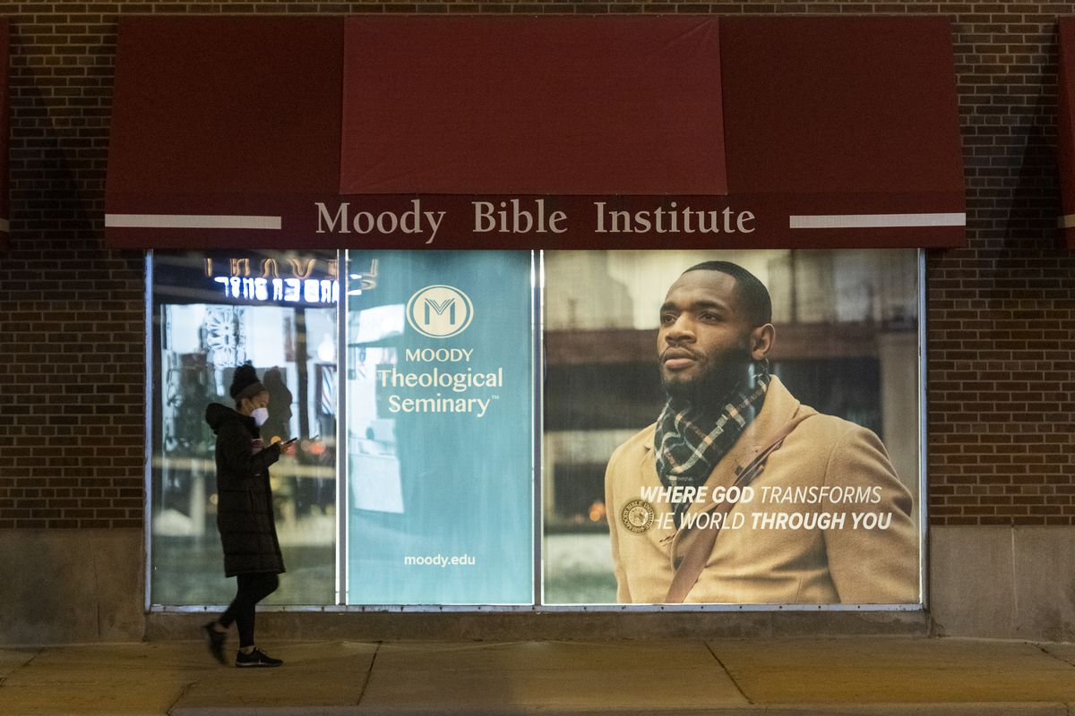 A woman walks by the Moody Bible Institute located at 820 N. LaSalle Dr.