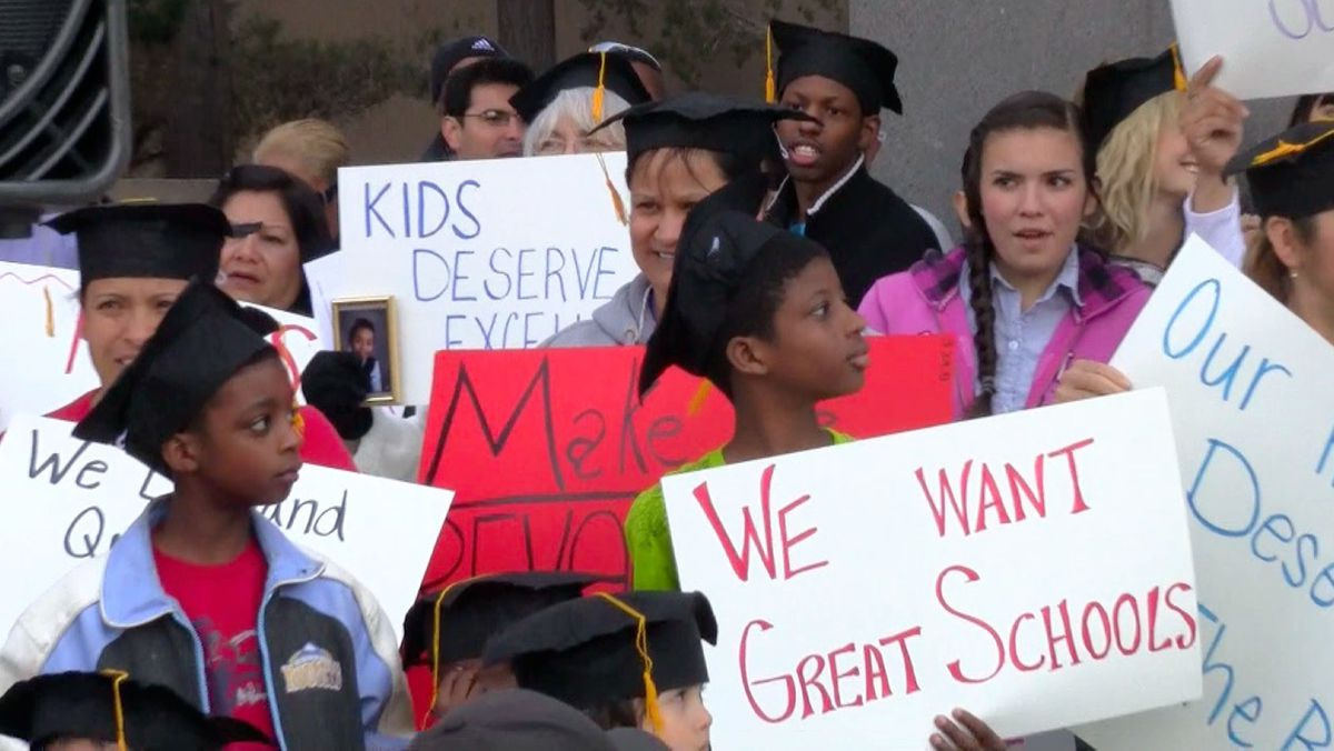 Tensions around education reform are evident in demonstrations such as this gathering in support of a Denver Public Schools' proposal in Far Northeast Denver. <em>EdNews</em> file photo.