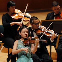 Shenae Anderson performs on the violin during the 55th annual Salute to Youth concert in Salt Lake City Tuesday, Sept. 30, 2014.