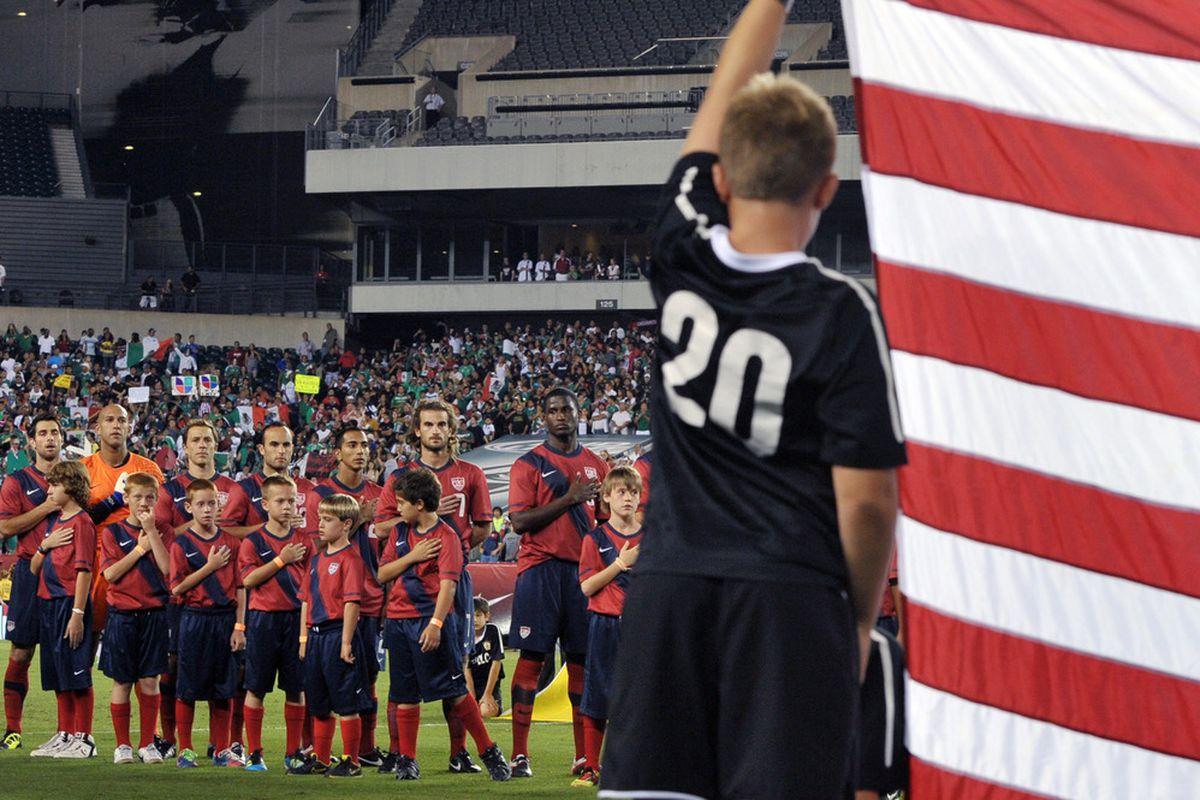PHILADELPHIA, PA - AUGUST 10:  The United States men's soccer team observe the National Anthem before the game against Mexico at Lincoln Financial Field on August 10, 2011 in Philadelphia, Pennsylvania. (Photo by Drew Hallowell/Getty Images)