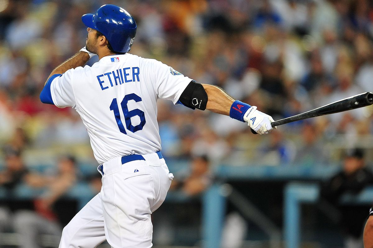 August 24, 2012; Los Angeles, CA, USA; Los Angeles Dodgers right fielder Andre Ethier (16) hits a two run home run in the first inning against the Miami Marlins at Dodger Stadium. Mandatory Credit: Gary A. Vasquez-US PRESSWIRE