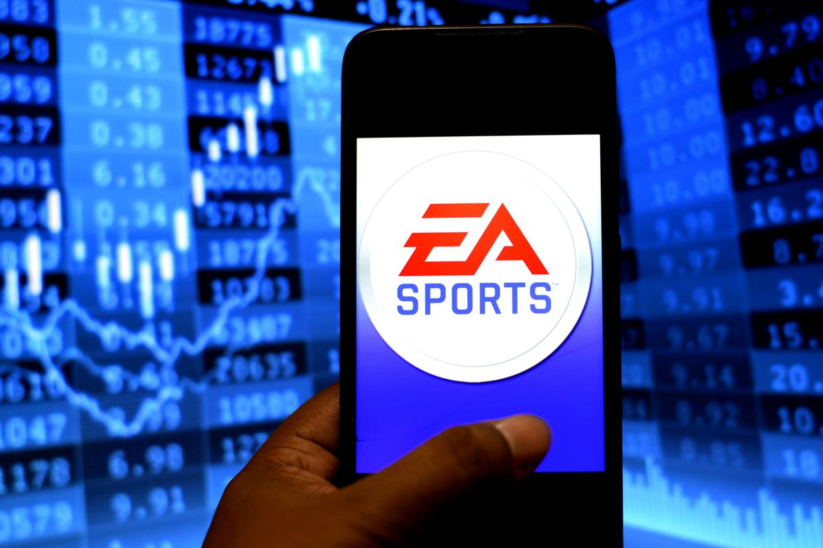 In this photo illustration an EA Sports logo seen displayed...