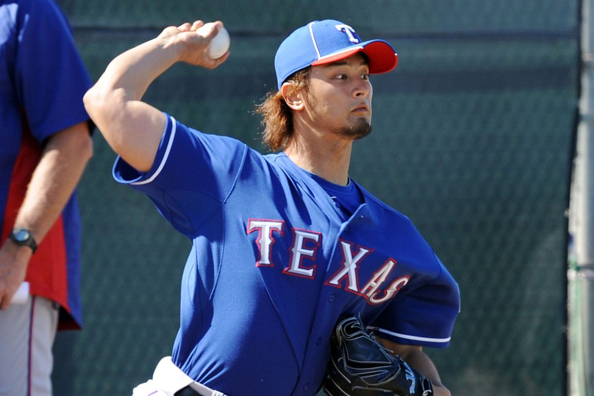 SURPRISE, AZ - FEBRUARY 23:  Yu Darvish #11 of the Texas Rangers throws from the bullpen during spring workouts at Surprise Stadium on February 23, 2012 in Surprise, Arizona.  (Photo by Norm Hall/Getty Images)
