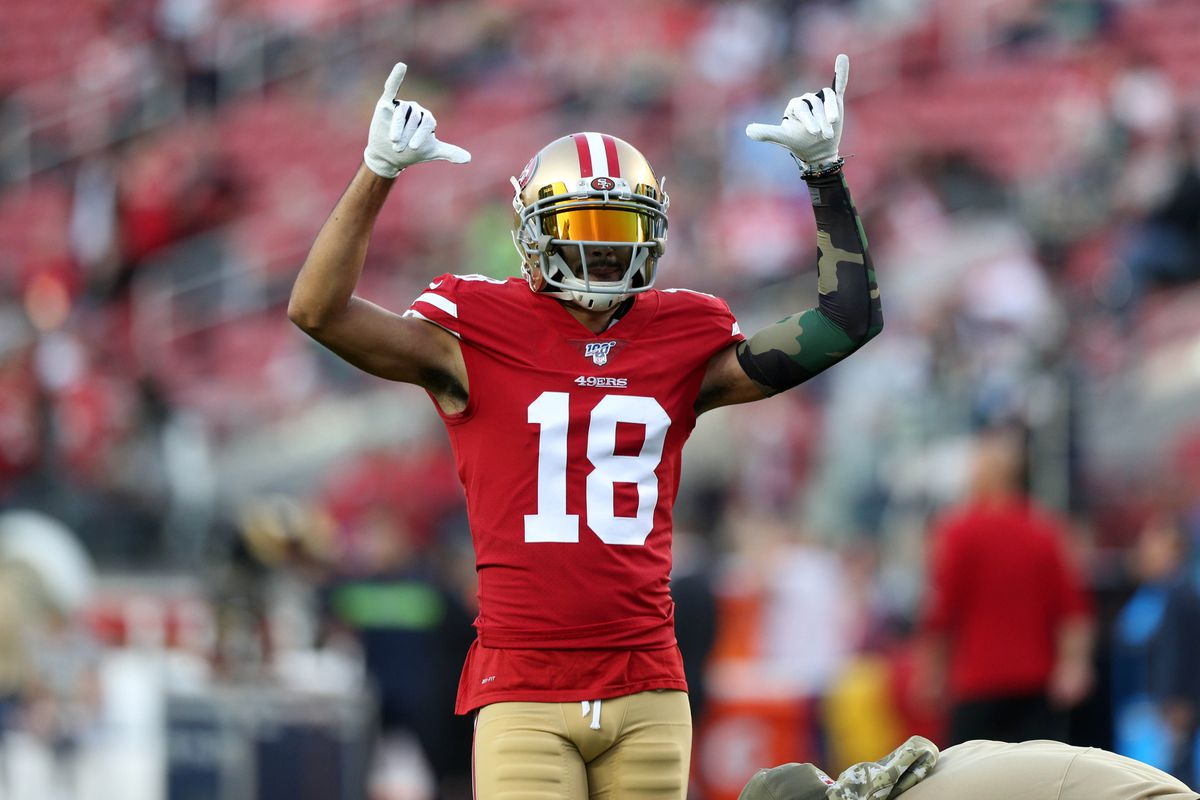 San Francisco 49ers wide receiver Dante Pettis interacts with fans before the start of the game against the Seattle Seahawks at Levi's Stadium.
