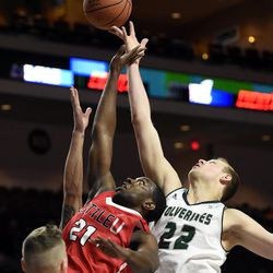 Seattle's William Powell (21) and Utah Valley's Isaac Neilson vie for a rebound during the second half of an NCAA college basketball game in the first round of the Western Athletic Conference tournament Thursday, March 9, 2017, in Las Vegas.