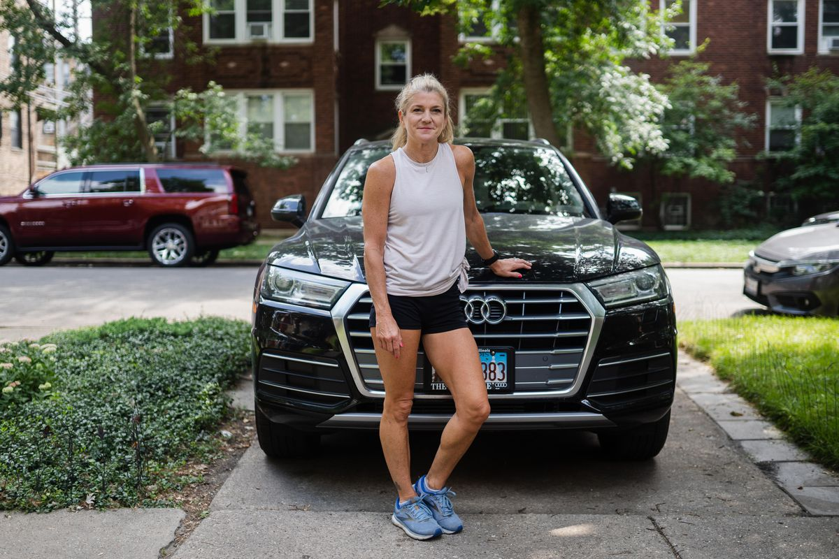 Karie Valentino poses for a photo with her car in the Ravenswood neighborhood yesterday.