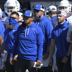 Boise State head coach Andy Avalos watches as the Broncos play Utah State during the second half of an NCAA college football game Saturday, Sept. 25, 2021, in Logan, Utah.