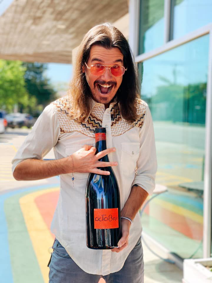 Alex Wheatley Bell with a three-liter bottle of wine