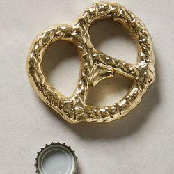 "<b>Anthropologie</b> pretzel bottle opener, <a href=""http://www.anthropologie.com/anthro/product/shopgifts-under-thirty/33605692.jsp#/"">$10</a>"