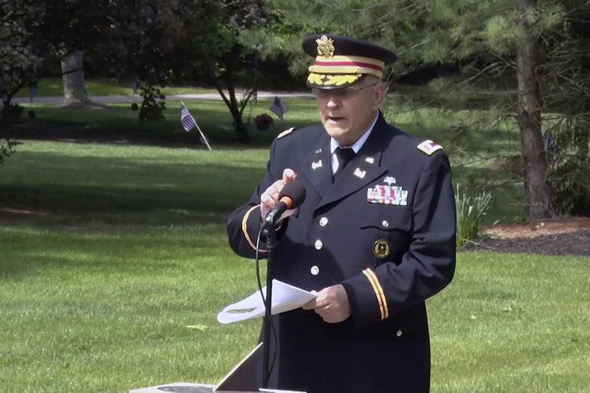 In this frame grab from video provided by Hudson Community Television, retired Army Lt. Col. Barnard Kemter taps the microphone after organizers turned off the audio during his speech at a Memorial Day ceremony, Monday, May 31, 2021, in Hudson, Ohio. Organizers of the ceremony turned off Kemter's microphone when he began talking about how freed Black slaves had honored fallen soldiers soon after the Civil War.