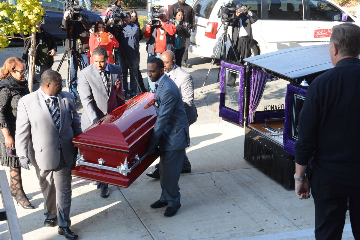 The casket for nine-year-old Tyshawn Lee is carried into St. Sabina Church on Nov. 10, 2015.