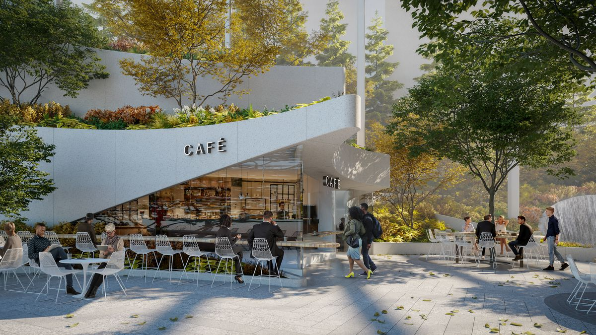 A cafe surrounded by trees and a seating area.