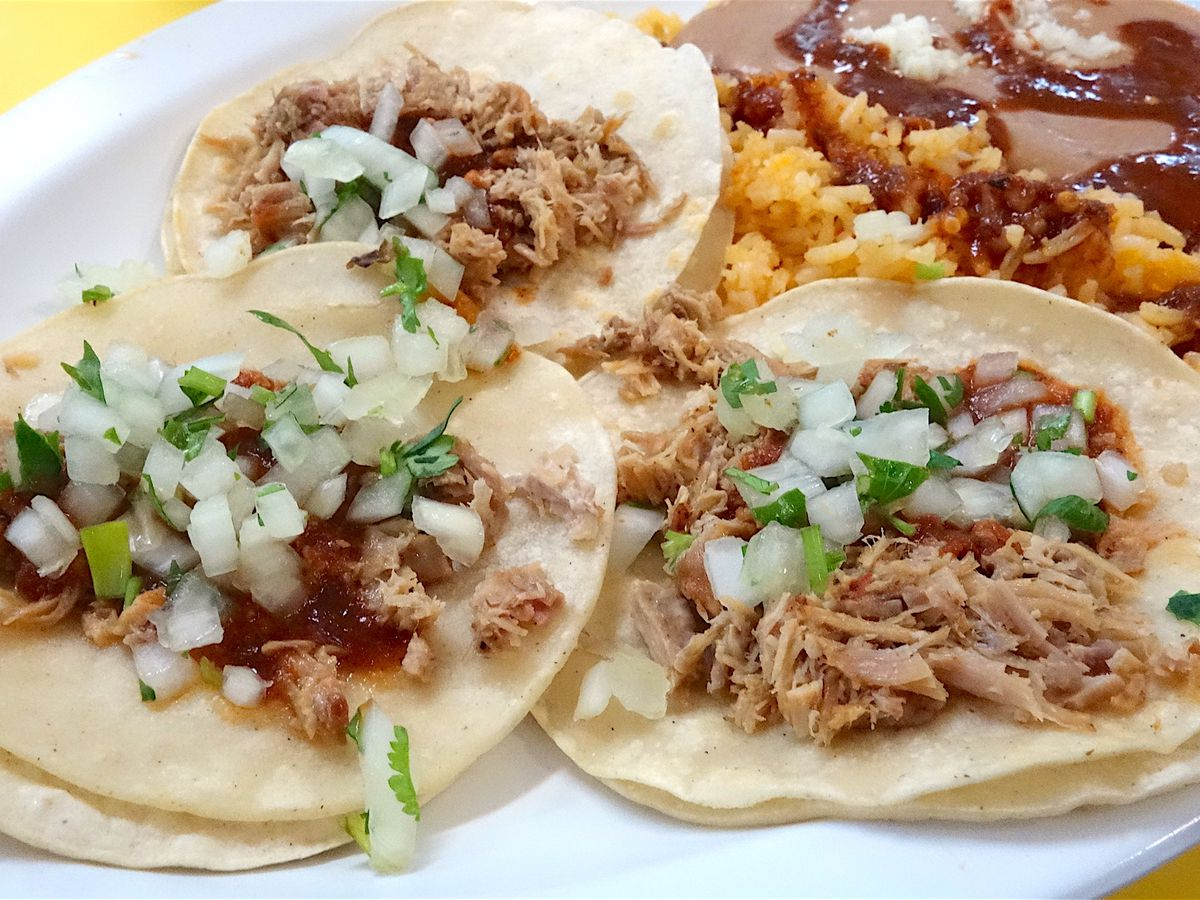Three tacos with beans and rice
