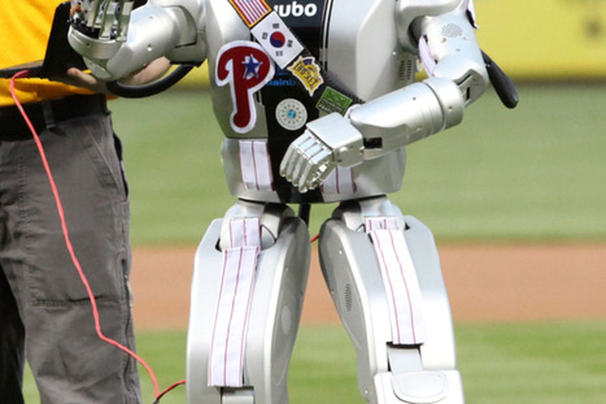 Igor the Robot throws out the ceremonial first pitch before a game between the Philadelphia Phillies and the Chicago Cubs at Citizens Bank Park in Philadelphia, Pennsylvania. The Phillies won 5-2. (Photo by Hunter Martin/Getty Images)
